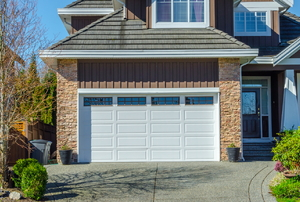 A garage with a white door.