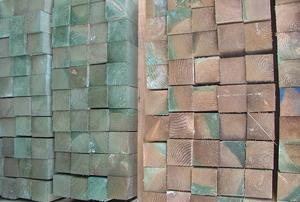 Piles of pressure-treated lumber