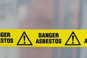 "A sign that says ""Danger Asbestos."""