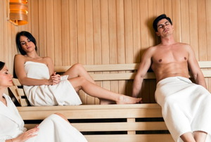 Three people in a sauna.