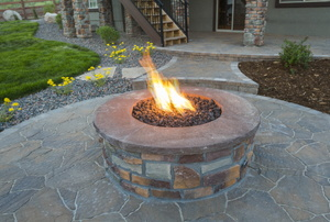 flames rising from a patio fire pit