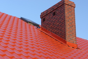 Roof flashing on a red roof.