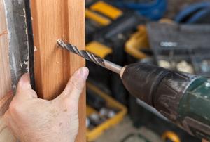 A man installing a door jamb.