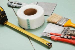 Using FibaTape Self-Adhesive Drywall Joint Tape