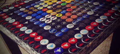 Upcycle Beer Bottle Caps Into A Table Doityourself Com