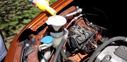 Replacing a Power Steering Reservoir | DoItYourself com