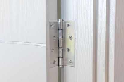 Silver Hinge On A White Door