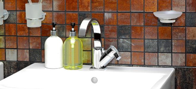soap in dispensers on bathroom sink