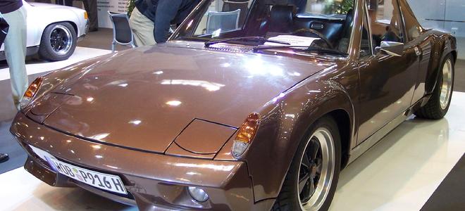 brown Porsche 916 with curvy hood in showroom