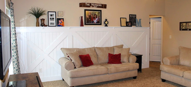 seating area with barn door wainscoting