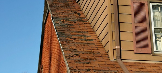 roof with loose or broken shingles