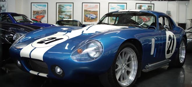 sleek, curvy, blue race car with the number 21 on the hood