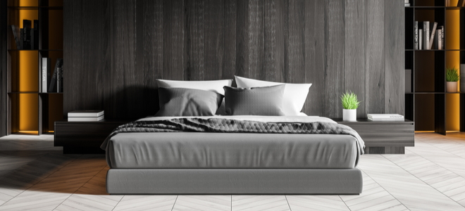 Contemporary bedroom with grey bed, night stands, and curtain behind them