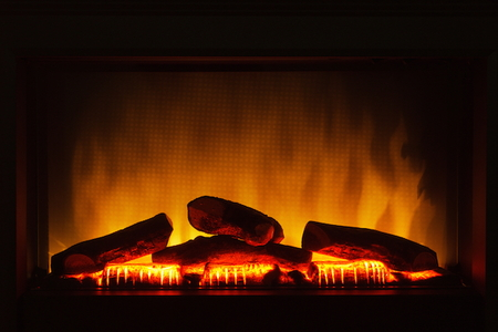 How to Make a Noisy Electric Fireplace Quiet | DoItYourself.com