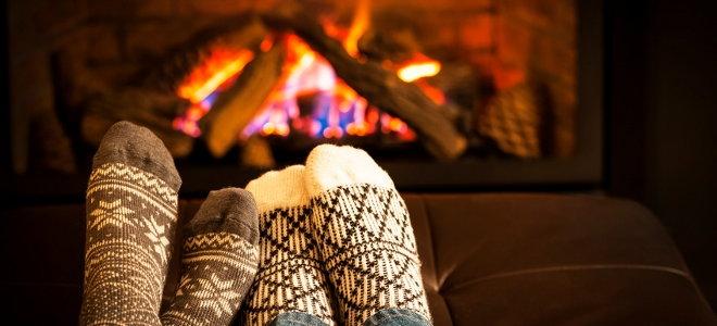 Feet in warm socks warming up by a fire.