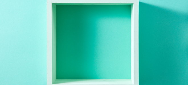 Shadowbox on bright teal wall