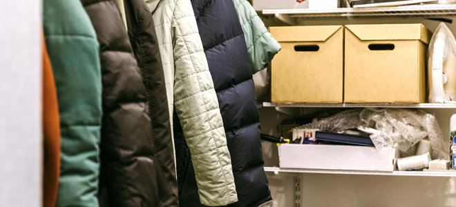 messy closet with jackets and drawers