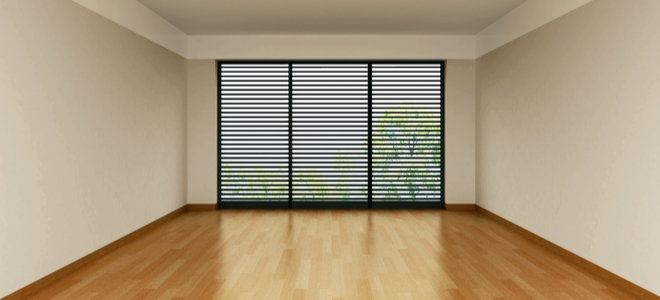 empty room with wooden floor and large window