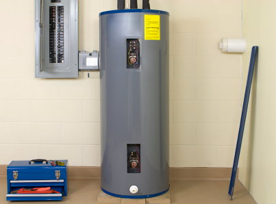 water heater with tool box and circuit breaker panel nearby