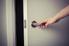 opening a door using a door lever handle.