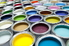 Paint cans in an array of colors.