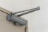 a hydraulic door closer at the top of a door