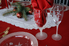 etched glasses and plate on a table set for Christmas