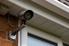 a camera mounted to the side of a house.