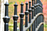 A close-up of a black iron fence with pointed slats.