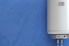 A heater on a blue background.