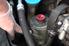 power steering reservoir in an engine