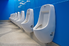 Men's bathroom with a row of urinals