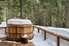 cedar hot tub on a deck in the snow