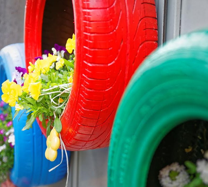colorful hanging tire planters