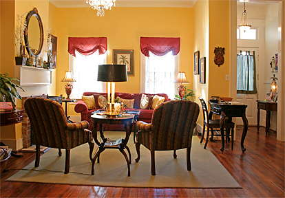 Savannah's southern welcome and friendly reputation plays out in the inn's living room with cozy fireplace.