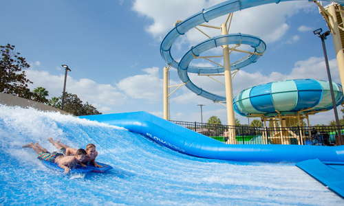 Cypress Springs Water Park features a FlowRider surf simulator and drop slides