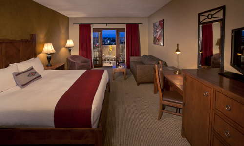 Spacious guest rooms feature New Mexico Revival decor, handcrafted native inspired furniture and local art pieces, and some offer balconies with views of Santa Fe city and the Sangre de Cristo mountains.
