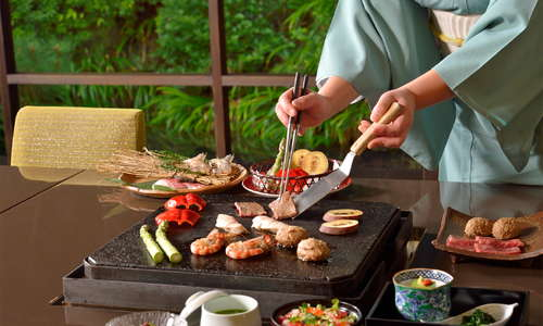 Seasonal ingredients including Japanese beef are grilled on the lava rock from Mt. Fuji