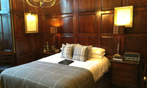 Deluxe Tudor room boasting Tudor paneled walls, solid mahogany bed and furniture, Smart tvs dab Bluetooth radio and much more