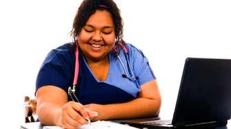 A Nursing Student At Her Desk.