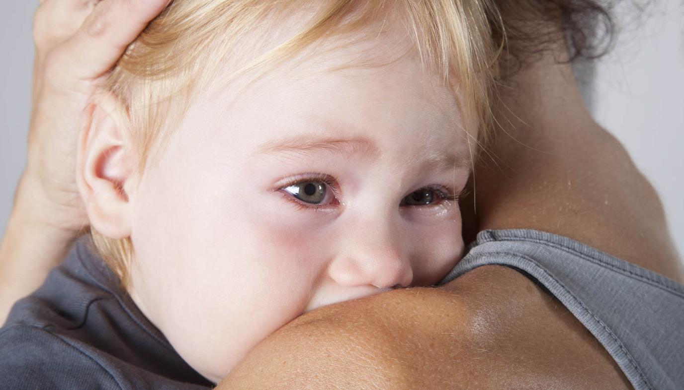 mom comforting crying baby