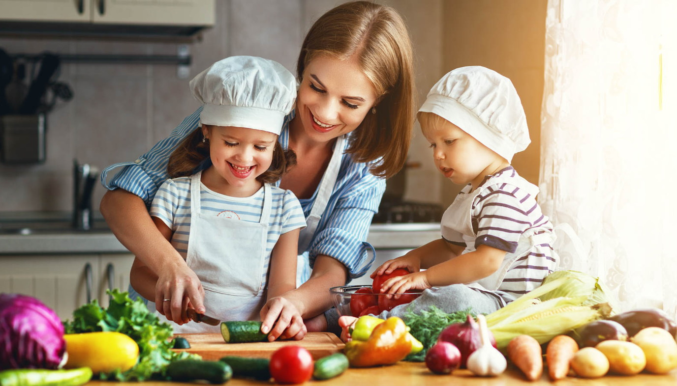 mom cooking dinner with children