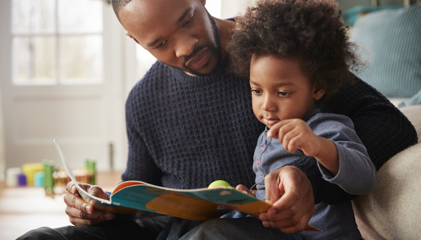 dad reading book to son