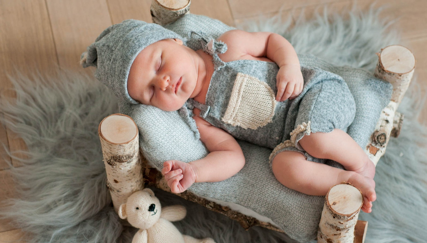 adorable baby sleeiping on bench