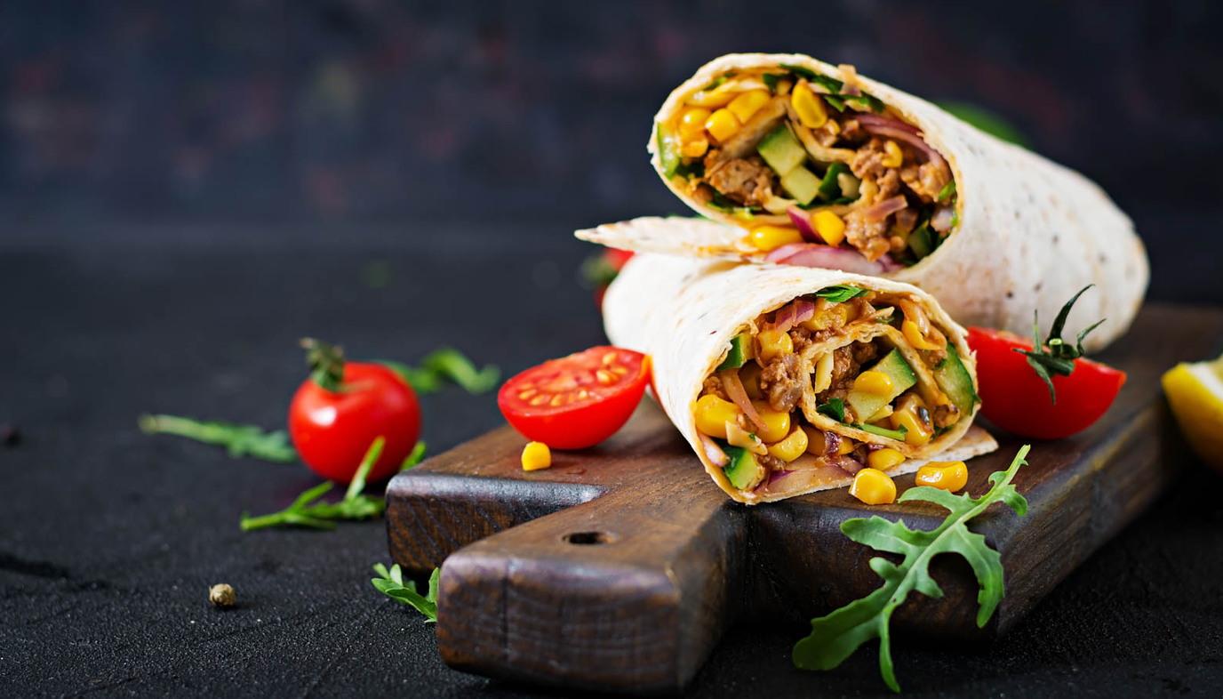 burritos on a cutting board