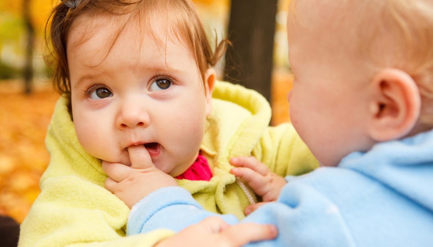 toddler biting baby's finger