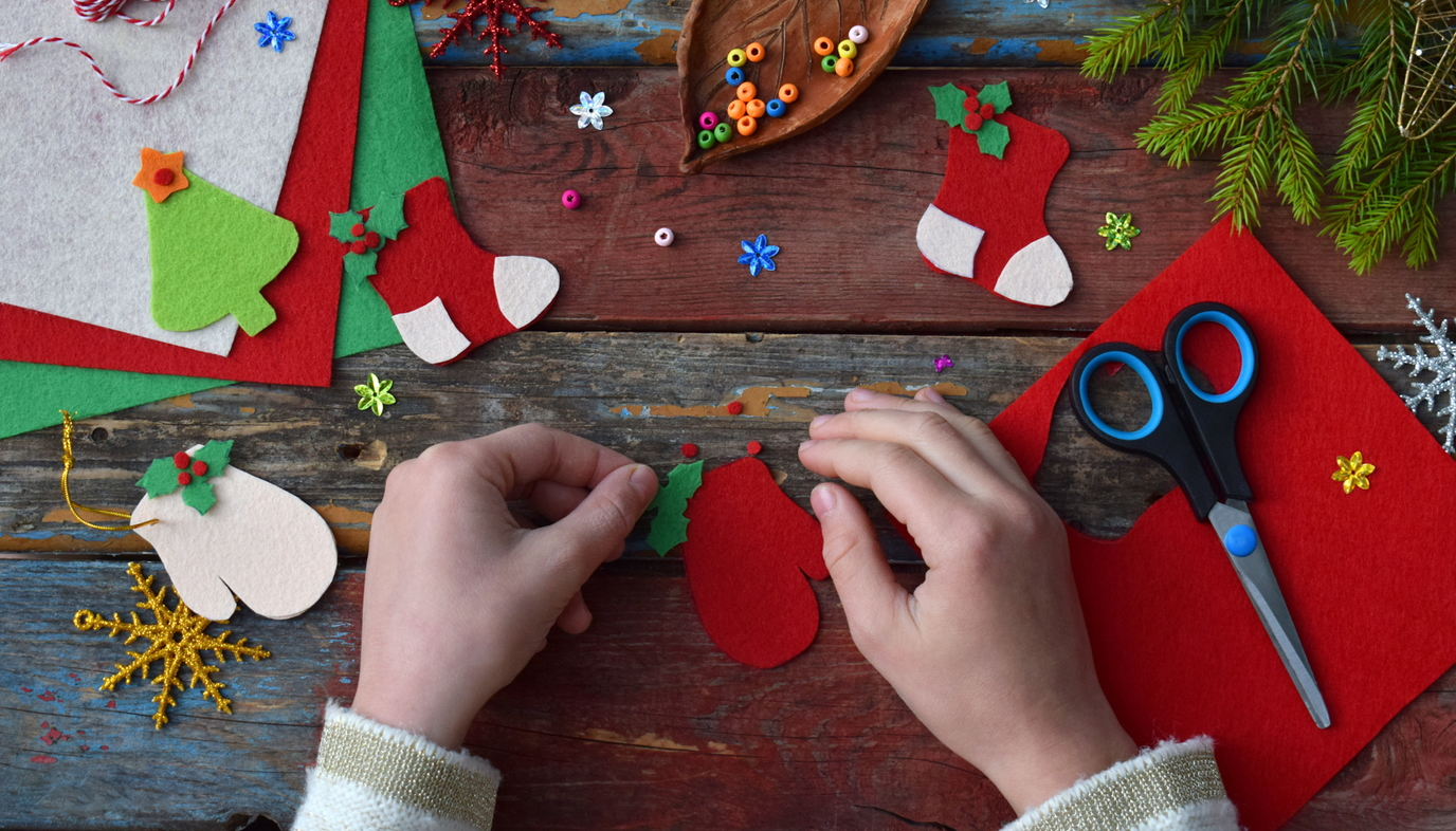 child working on Christmas crafts