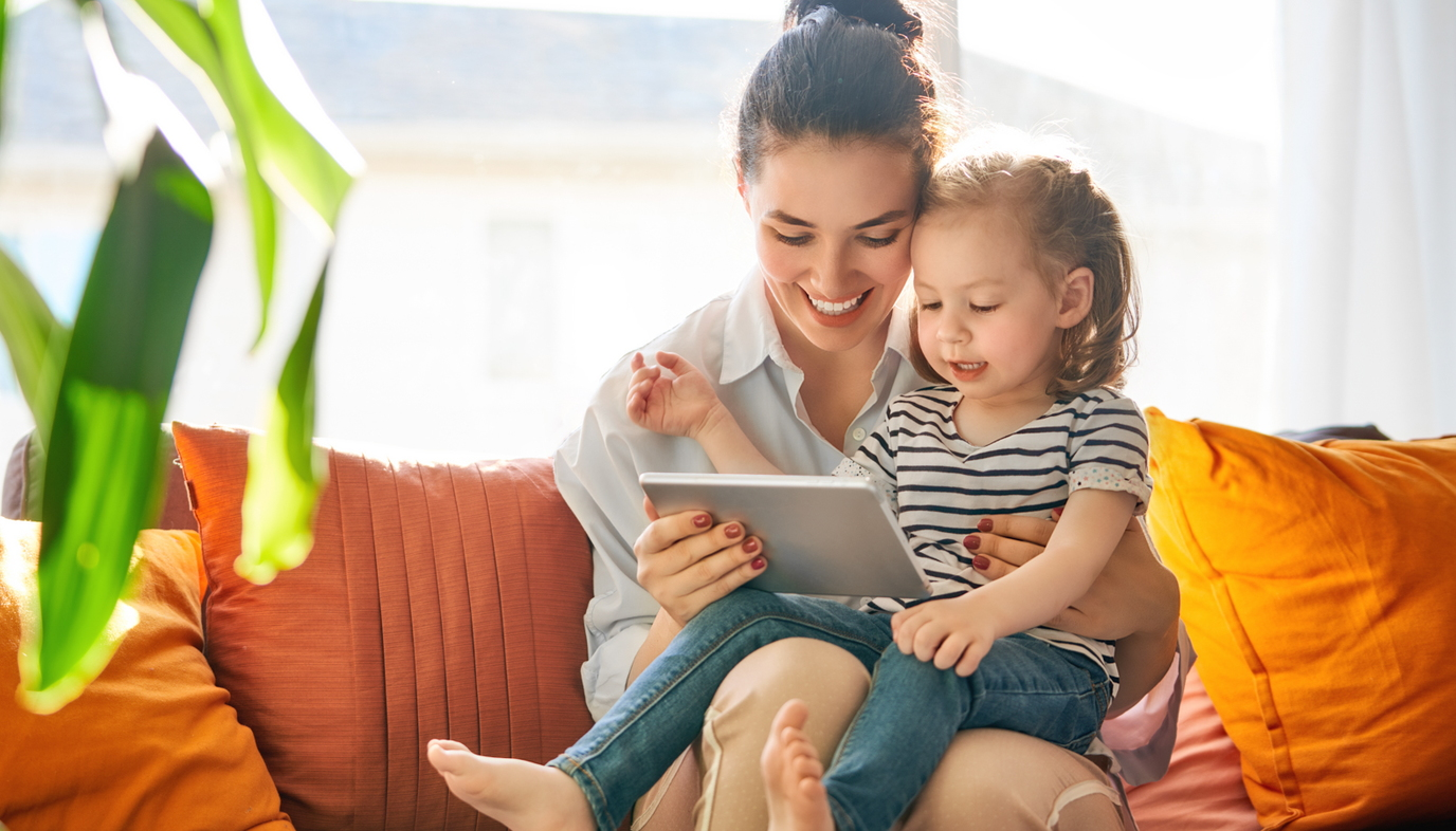 mom playing on tablet with girl