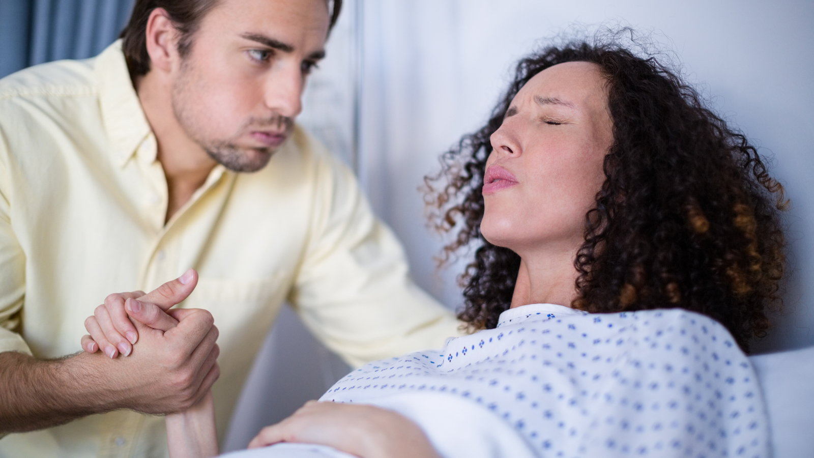 woman using lamaze breathing during birth