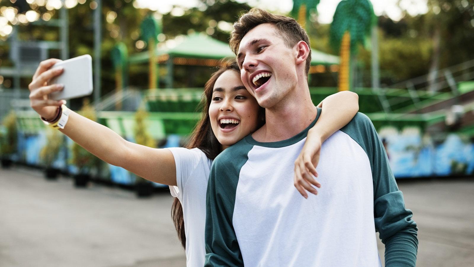 teen couple taking a selfie